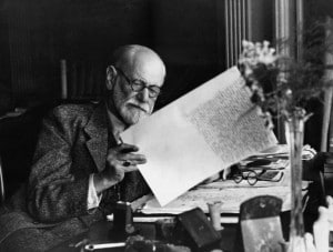 Original Caption: Sigmund Freud, 1856-1939, Austrian psychiatrist, in the office of his Vienna home looking at a manuscript. B/w photo ca.1930.